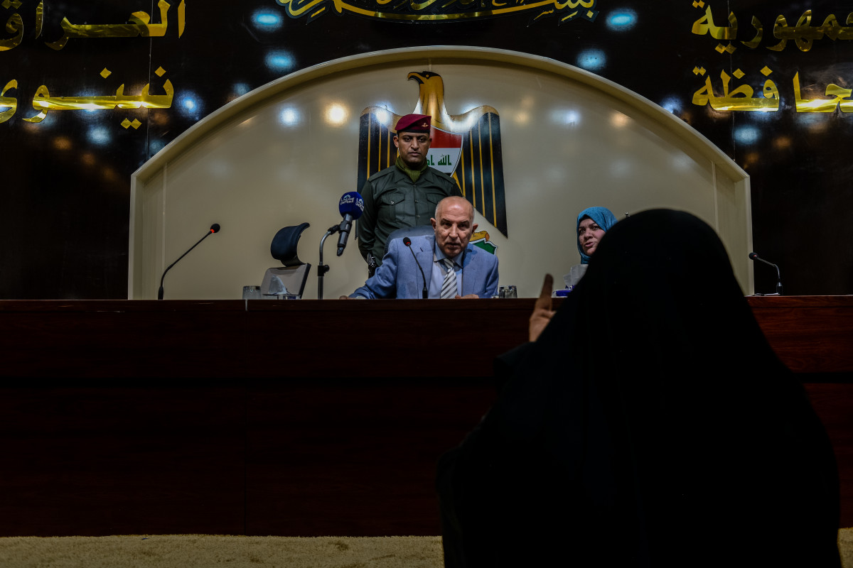 Mosul Governor Nofal Hammadi holds a public meeting to hear the concerns of citizens, and speaks to a widow who is asking for financial support.
