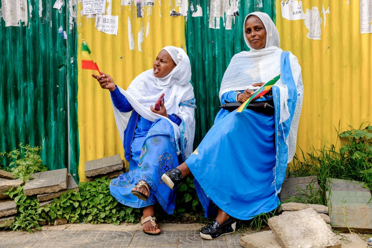 Women wave Ethiopian flags to celebrate the arrival of the Eritrean president in Addis Ababa on July 14th, 2018. President Isaias Afwerki arrived in Ethiopia for a historic visit to cement peace less than a week after the two nations declared an end to a two-decade conflict.