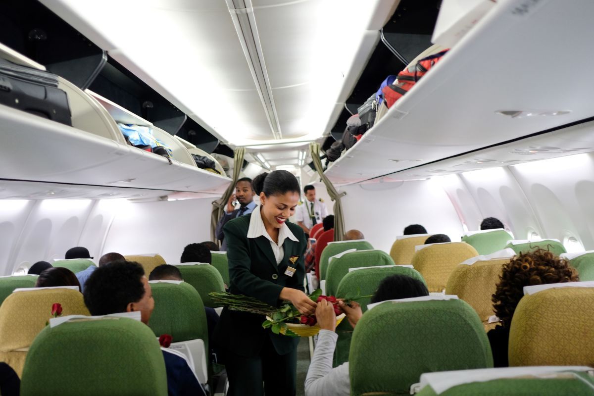 Ethiopian Airlines crew welcome passengers onboard the first commercial flight departing from Addis Ababa, Ethiopia, to Eritrea's capital of Asmara on July 18th, 2018.
