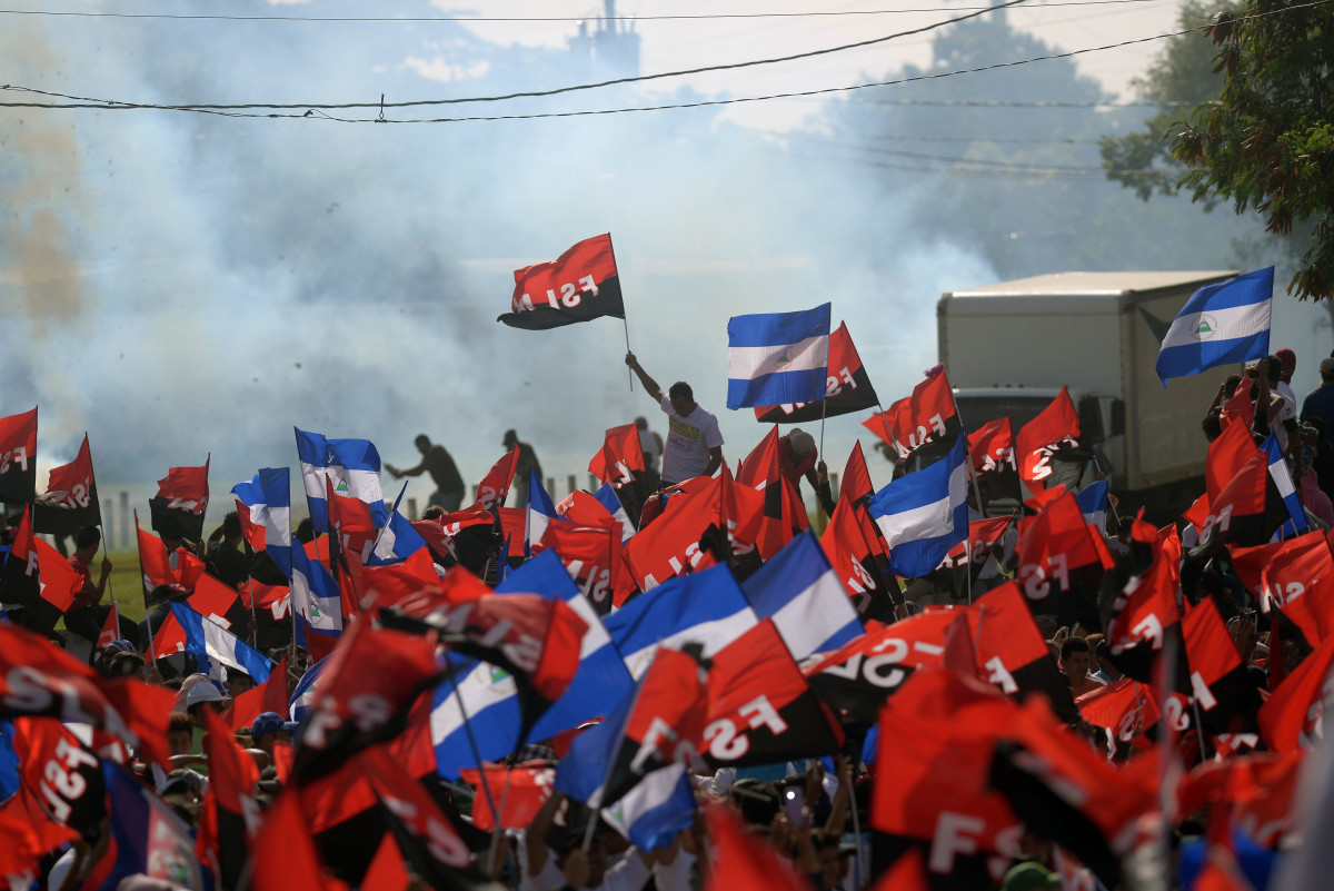 "Supporters of Nicaraguan President Daniel Ortega take part in the 39th Anniversary of the Sandinista Revolution at ""La Fe"" square in Managua on July 19th, 2018."