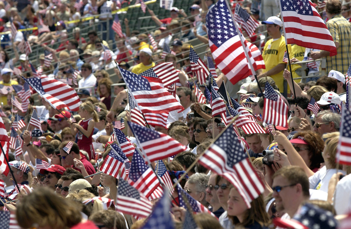 Supporters wave U.S. flags as they attend the Rally for America event at Marshall University stadium on May 24th, 2003, in Huntington, West Virginia.