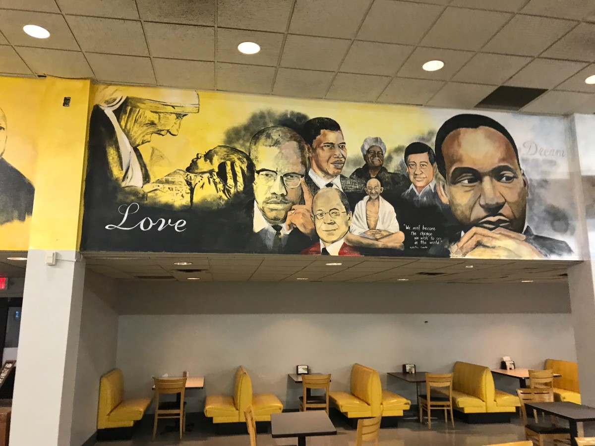 The dining hall walls at Paul Quinn College are painted with murals depicting famous African Americans and other heroes.