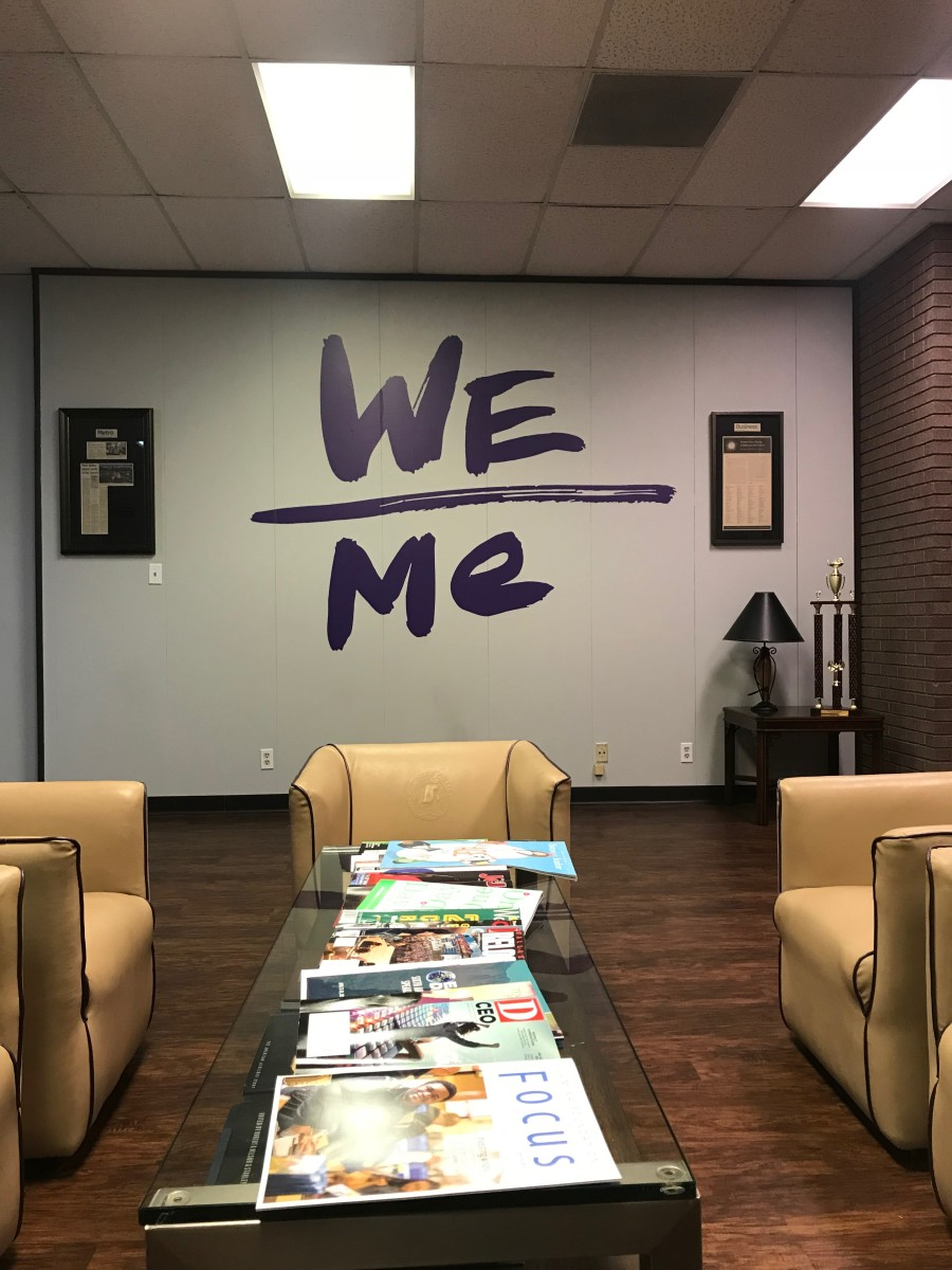 The Paul Quinn College mantra—We over me—is painted at various places around campus.
