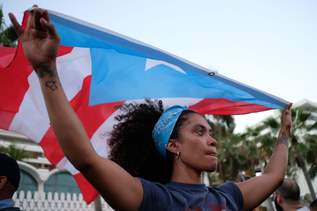 A woman displays the Puerto Rican flag in in San Juan, Puerto Rico, on May 2nd, 2018.