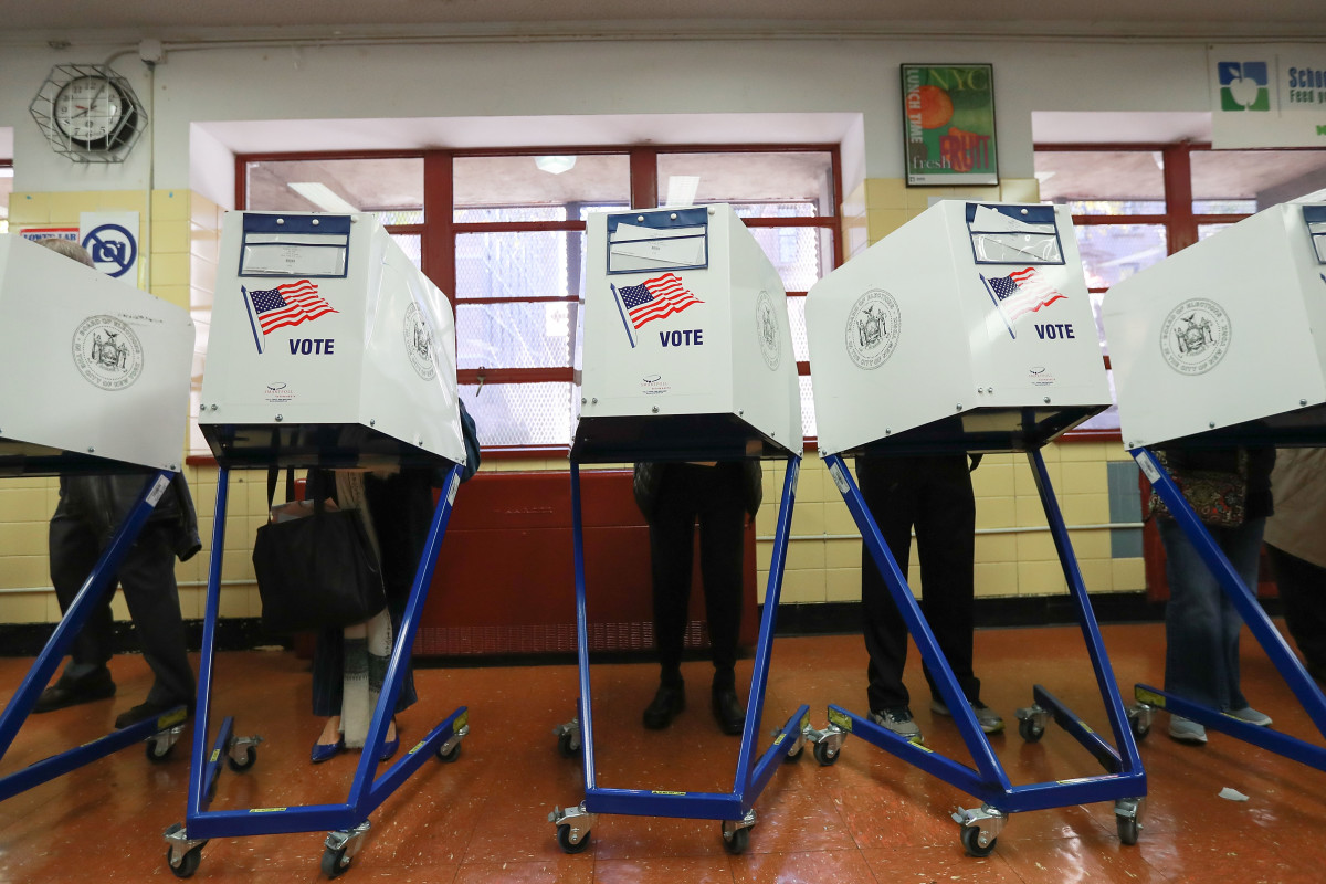 Voters cast their ballots at voting booths on November 8th, 2016, in New York City.