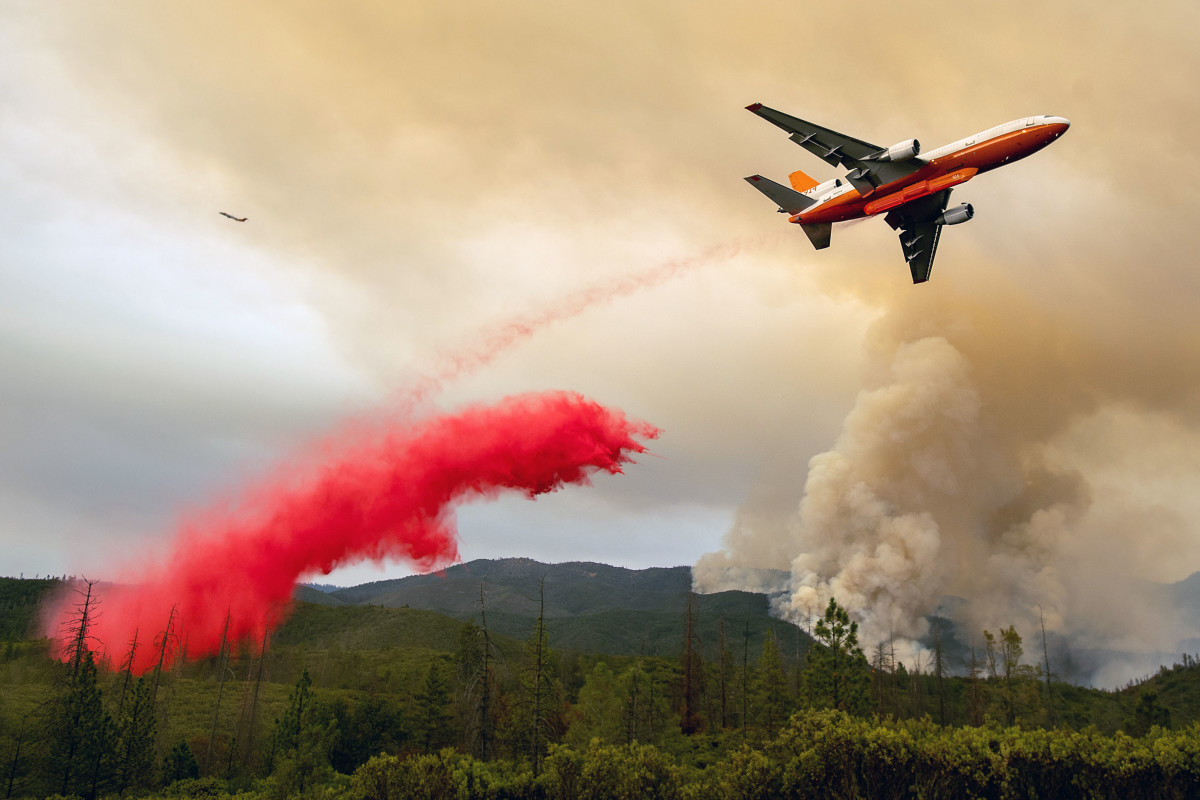 An air tanker drops retardant while battling the Ferguson Fire in the Stanislaus National Forest, near Yosemite National Park, on July 21st, 2018.