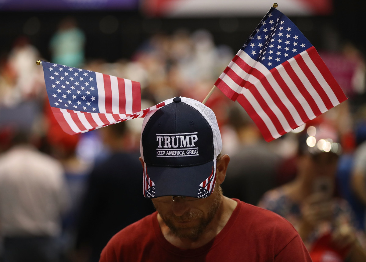 Mark Searles waits for the arrival of President Donald Trump at his Make America Great Again Rally at the Florida State Fair Grounds Expo Hall on July 31st, 2018, in Tampa, Florida.