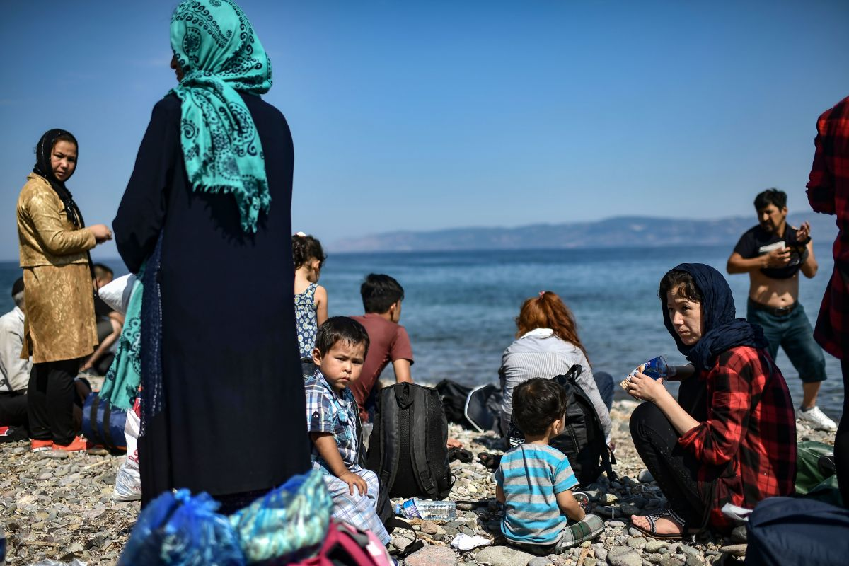 Migrants from Afghanistan arrive on the Greek island of Lesbos on August 6th, 2018, after crossing the Aegean Sea from Turkey on a dinghy. More than 1,500 refugees and migrants have died trying to cross the Mediterranean Sea to Europe in the first seven months of the year, according to the United Nations.