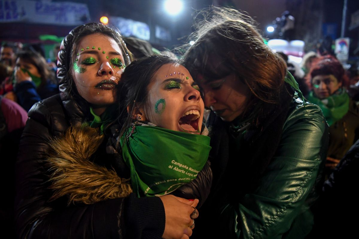 Abortion rights activists comfort each other outside the National Congress in Buenos Aires, Argentina, on August 9th, 2018, after senators rejected a bill that would have legalized abortion. Argentine senators voted against the bill on Thursday, dashing the hopes of women's rights groups after the bill was approved by Congress' lower house in June.