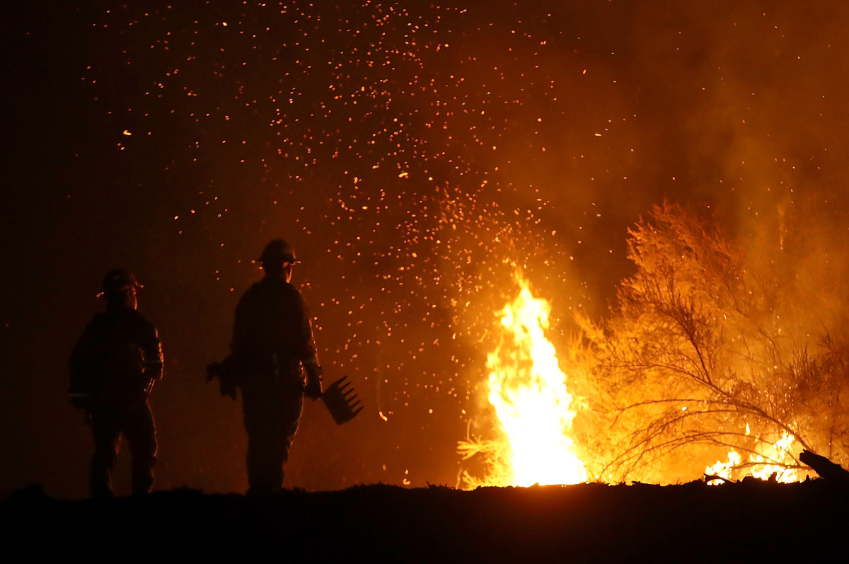 Firefighters battle the Medocino Complex Fire on August 7th, 2018, near Lodoga, California.