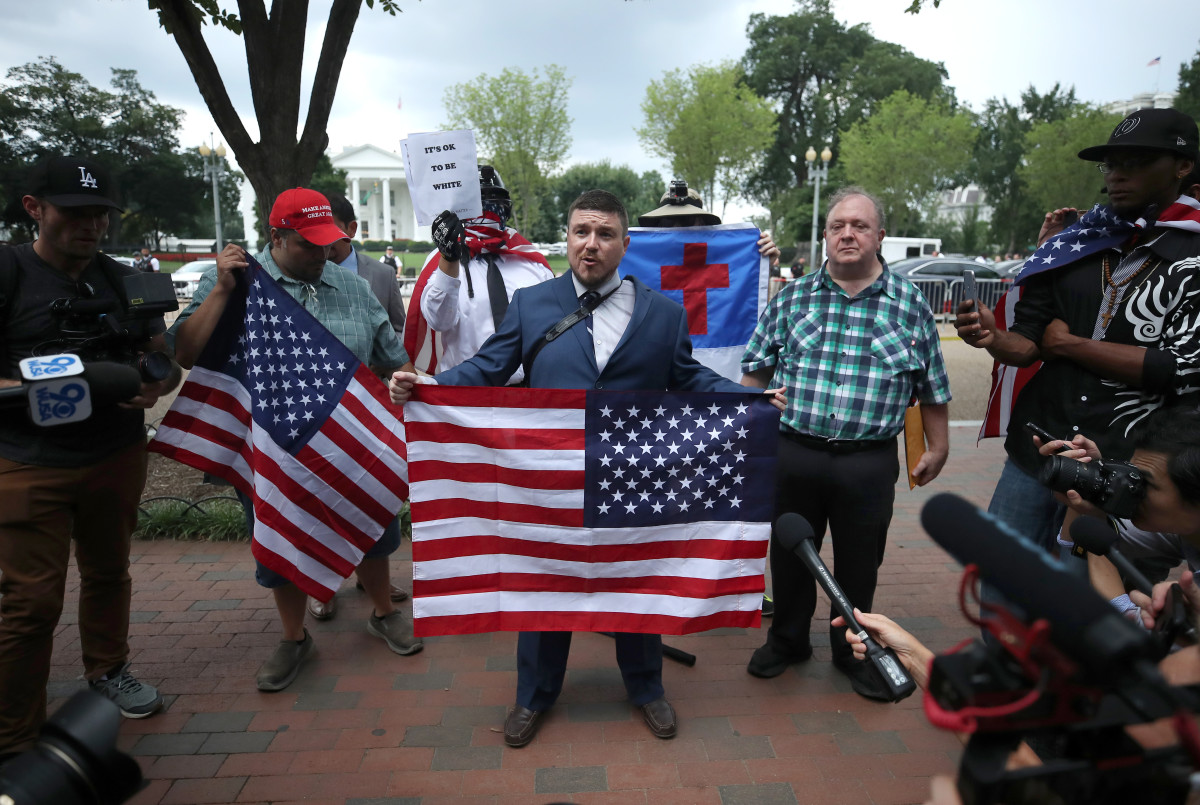 Jason Kessler (center), who organized the Unite the Right rally, speaks on August 12th, 2018, in Washington, D.C.