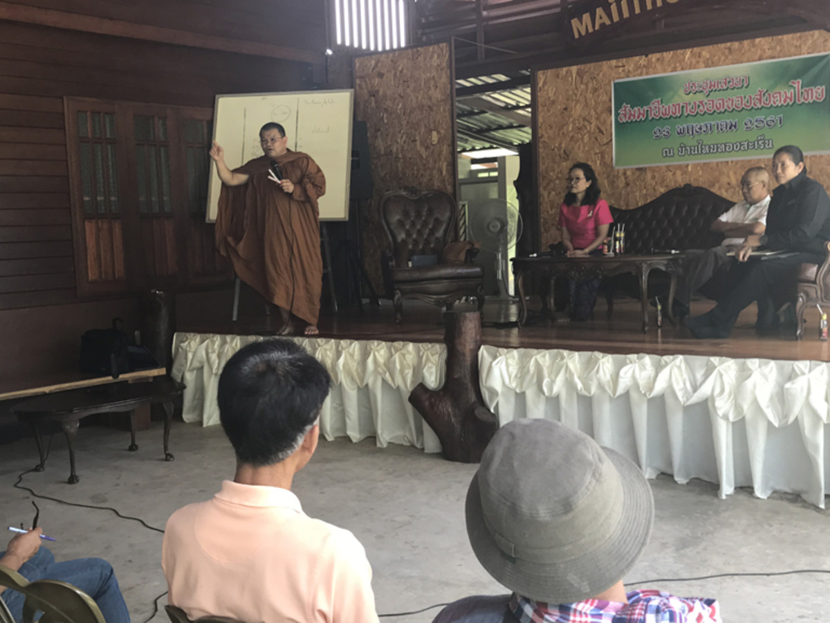 Phrakhu Sangkom Thanapanyo Khunsuri giving a speech on the importance of trees and stopping deforestation to the villagers of Surin, Thailand.