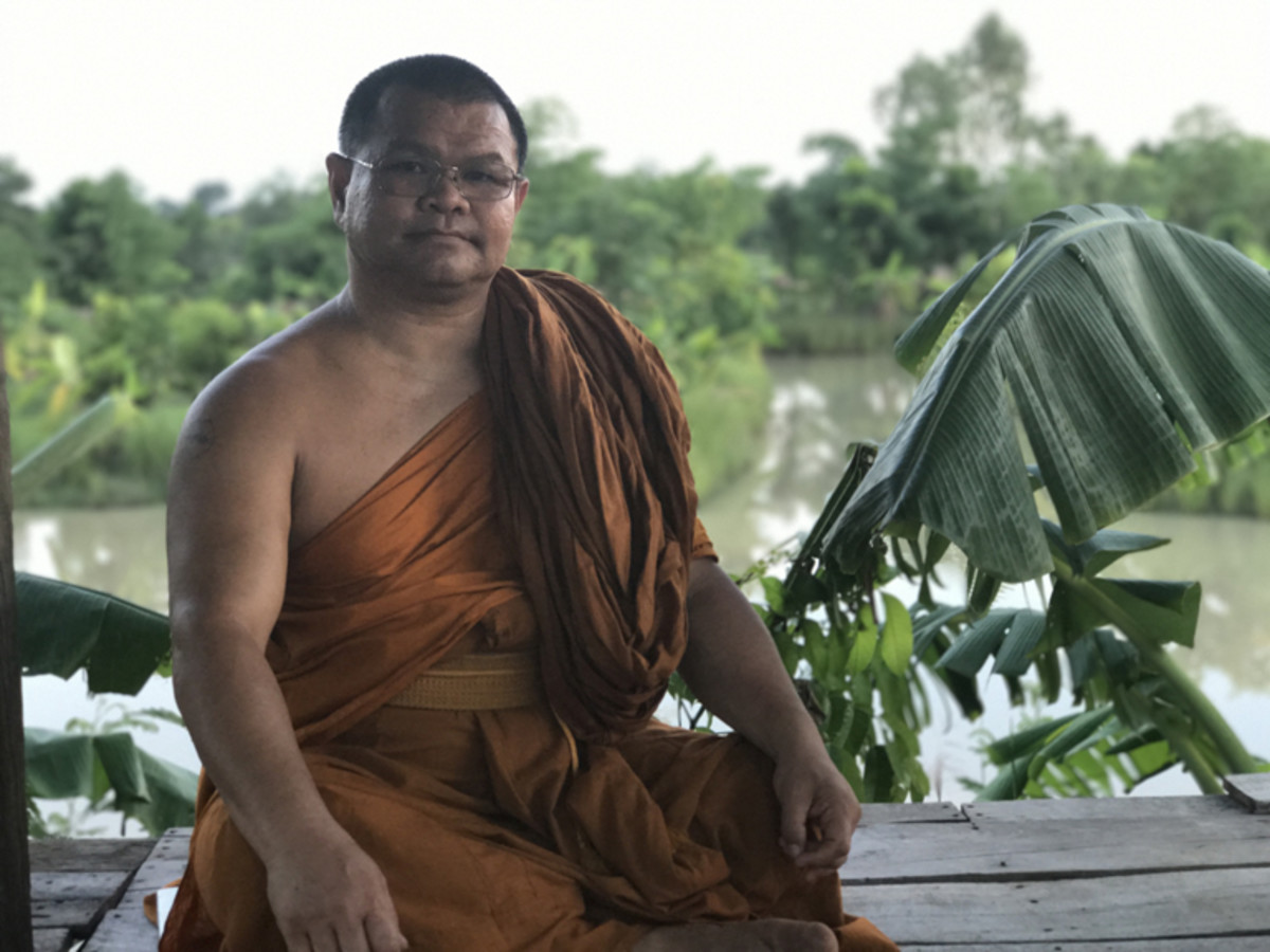 Phrakhu Sangkom Thanapanyo Khunsuri, an ecology monk, at his farm in Surin, Thailand, where he follows the philosophy of sufficiency economy by planting many different types of crops.