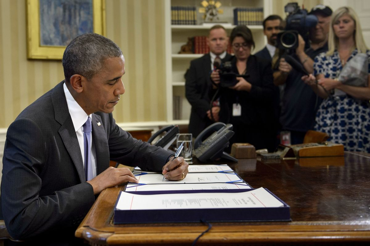Barack Obama signs the Freedom of Information Improvement Act into law in the Oval Office of the White House on June 30th, 2016, in Washington, D.C.