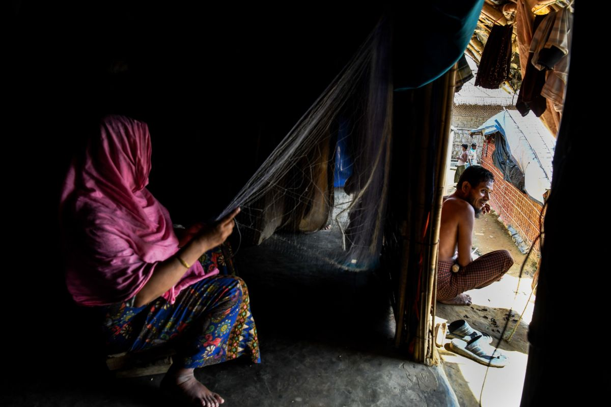 Rohingya refugee Toyoba, 40, makes a fishing net inside her tent in Kutupalong refugee camp in Ukhia on August 14th, 2018.