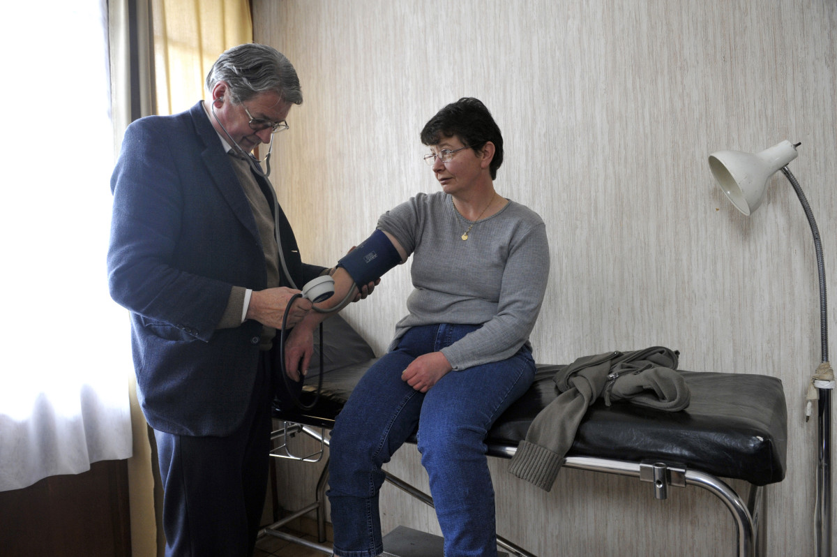 Pierre Brunie, a family doctor, examines a patient at his office, on January 29, 2013 in Eglisneuve-d'Entraigue.