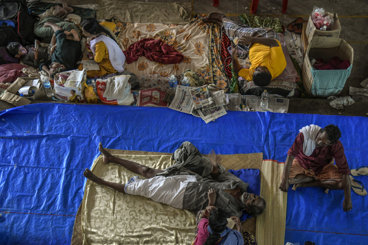 People rest at a relief camp in Aluva on August 22nd, 2018, in Kerala, India, where rescue efforts continue this week. Over 400 people have reportedly died in Kerala after weeks of monsoon rains, which forced more than one million people to take shelter in thousands of relief camps across the southern state.