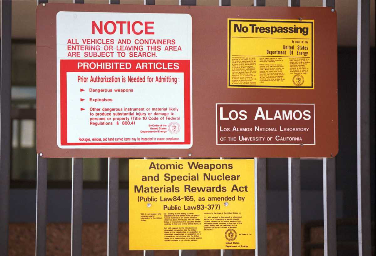Signs are posted on the gated wall around the main technical area of Los Alamos National Laboratory in New Mexico.