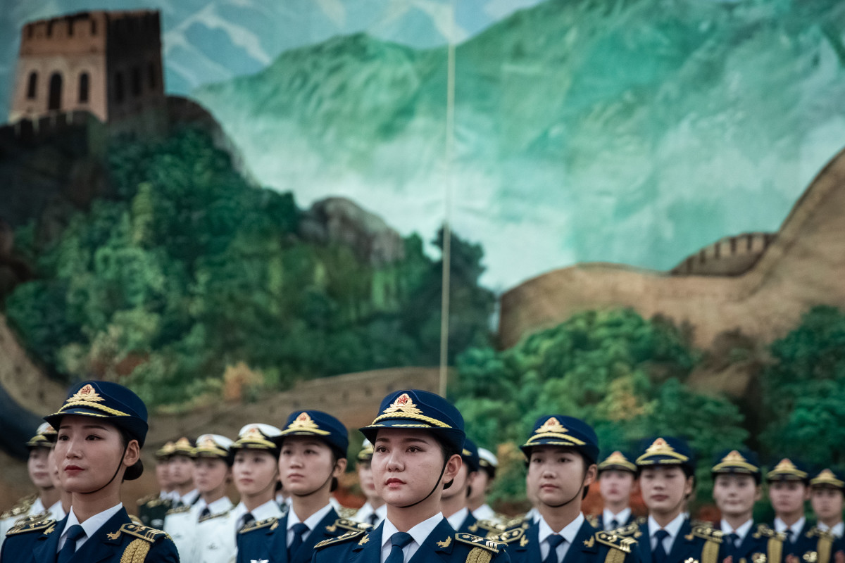 "Female members of the Chinese People's Liberation Army honor guard wait to greet Sierra Leone President Julius Maada Bio during a welcome ceremony in the Great Hall of the People on August 30th, 2018, in Beijing, China. Maada Bio is in China for the ""Forum on China-Africa Cooperation,"" which will be held from September 3rd to 4th in Beijing."
