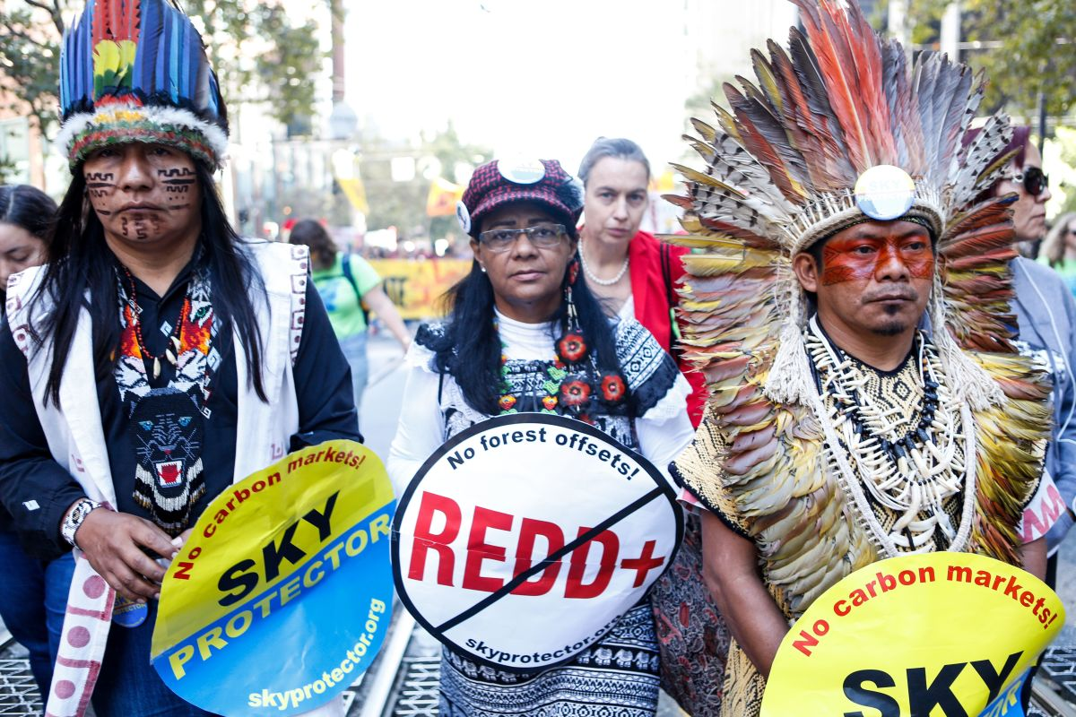 Chief Ninawá Inú Hunikui (right), president of the indigenous Federation of the Huni Kui People of the Brazilian Amazon, marches in San Francisco.
