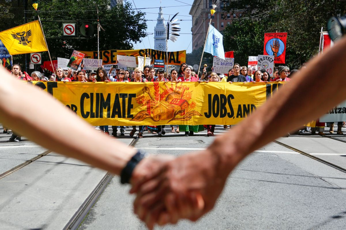 Demonstrators proceed up Market Street during the Rise for Climate global action in downtown San Francisco on September 8th, 2018, ahead of the Global Climate Action Summit.