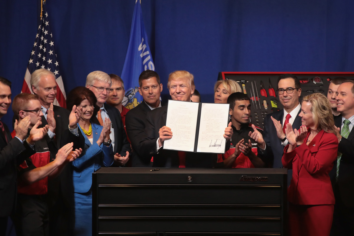 President Donald Trump signs an executive order to try to bring jobs back to American workers and revamp the H-1B visa guest worker program.