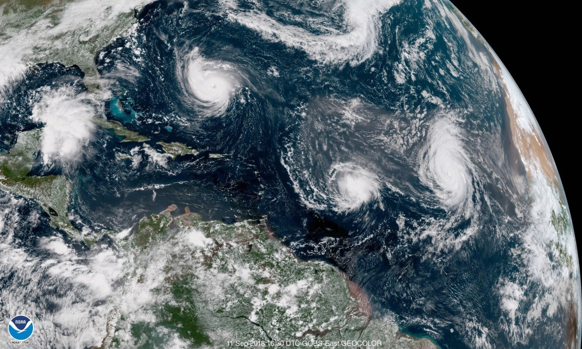 In this satellite image provided by the NOAA, Hurricane Florence churns through the Atlantic Ocean toward the U.S. East Coast, followed to the east first by Tropical Storm Isaac and then Hurricane Helene on September 11th, 2018.