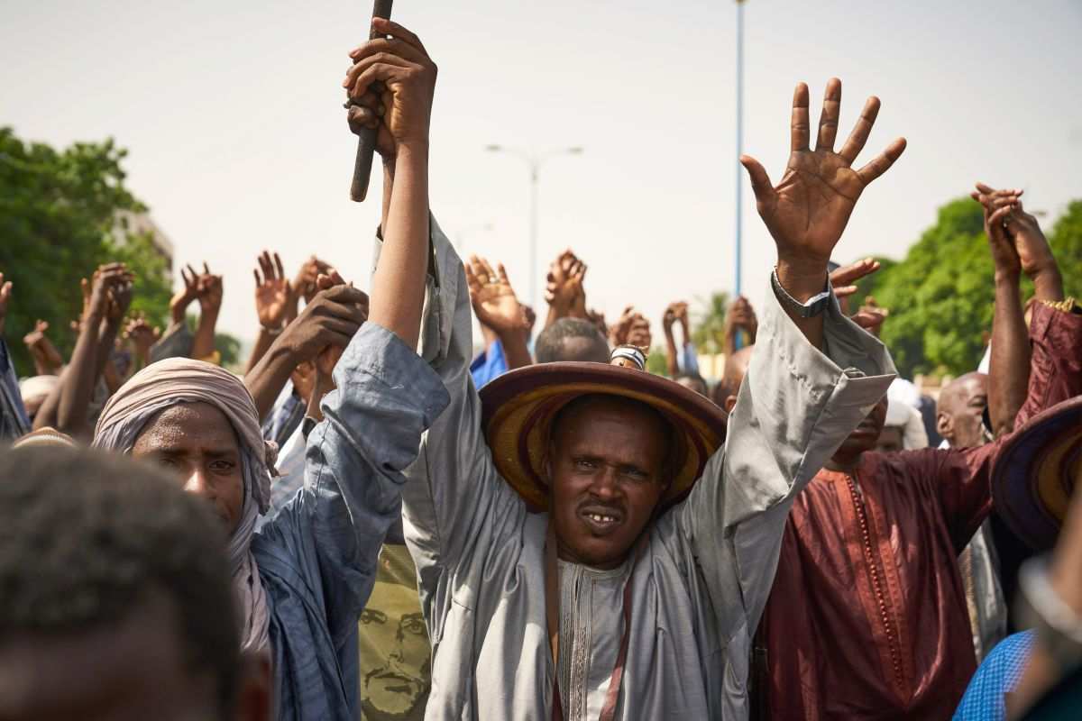 Fulani people protest during a silent march in response to a massacre in Koumaga, Mali.