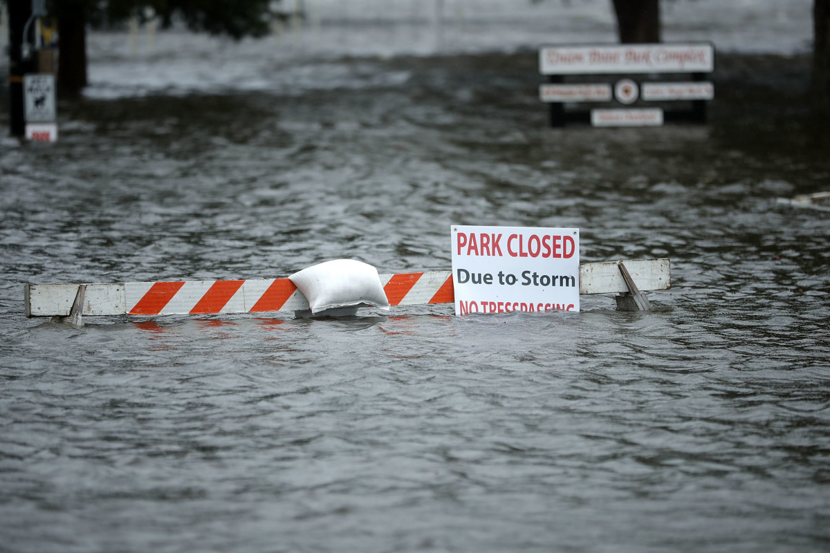 A sign warns people away from Union Point Park after it was flooded by the Neuse River during Hurricane Florence on September 13th, 2018 in New Bern, North Carolina.