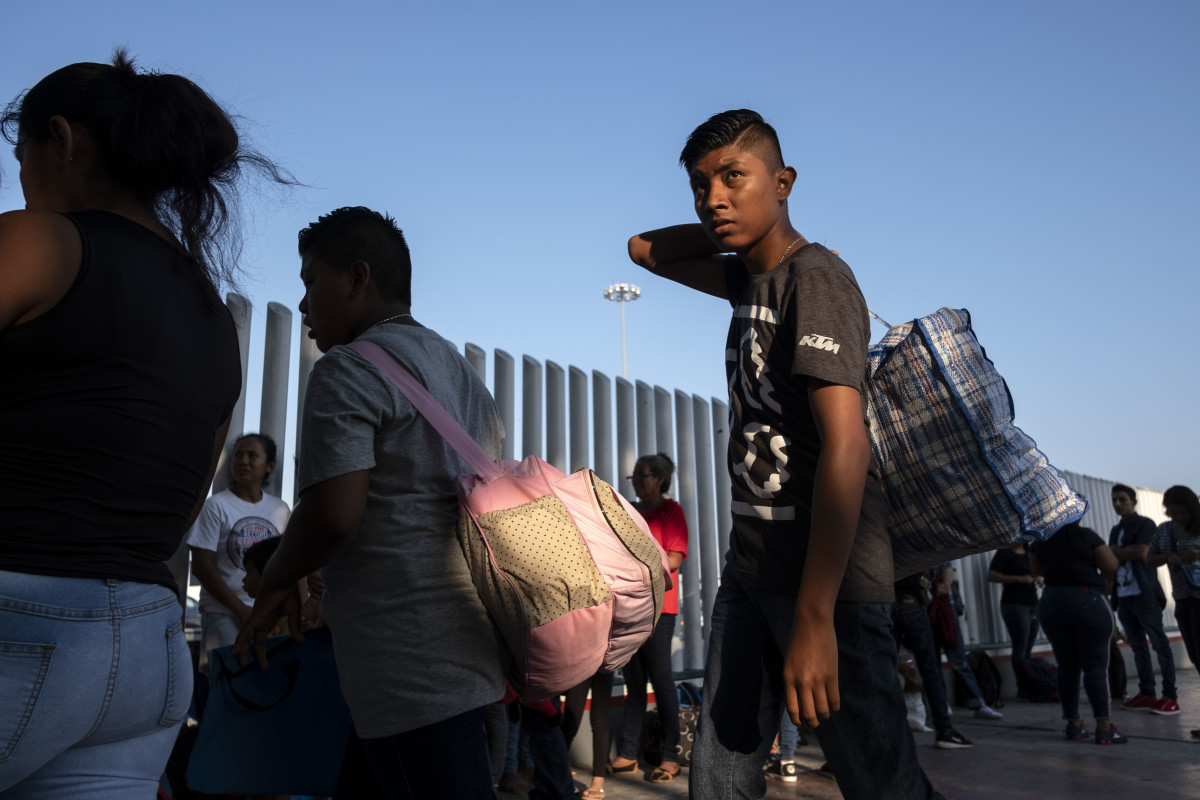 Asylum seekers gather at El Chaparral port of entry in Tijuana, Mexico, on August 10th, 2018, as they look for an appointment to present their asylum request before the United States authorities.