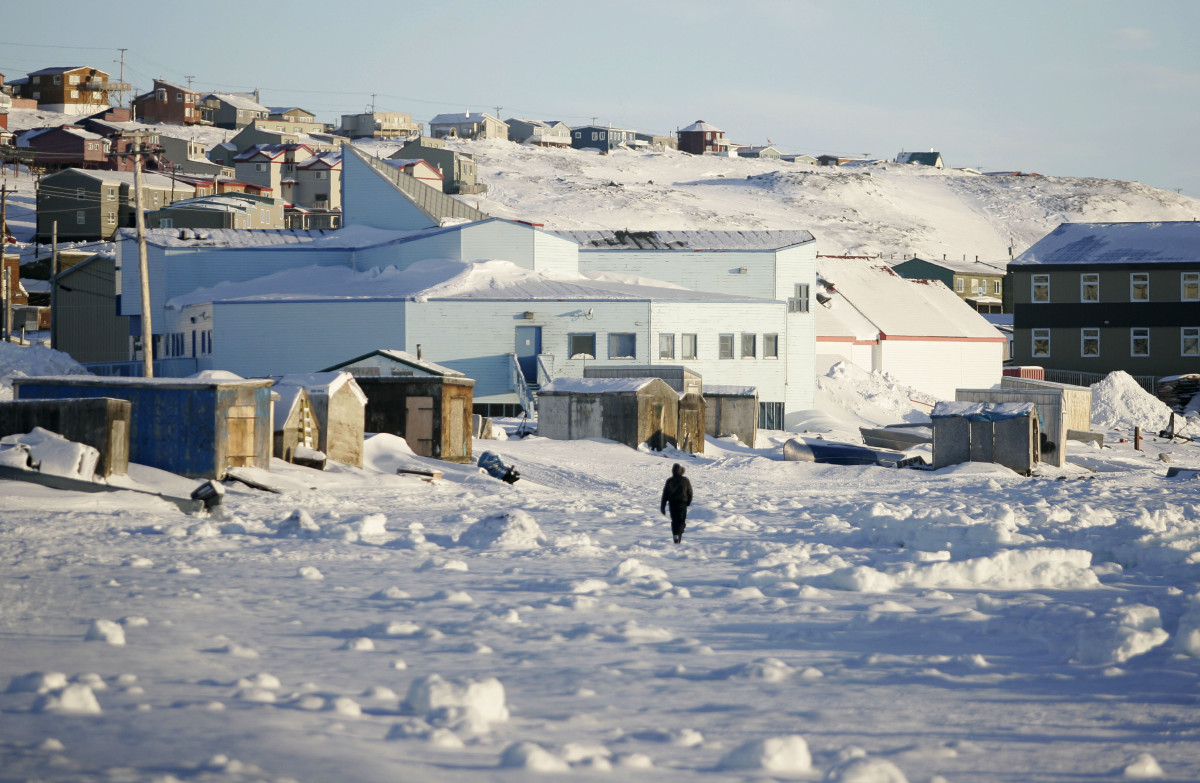 A man walks along the shoreline in Iqaluit, Canada, in February of 2010.