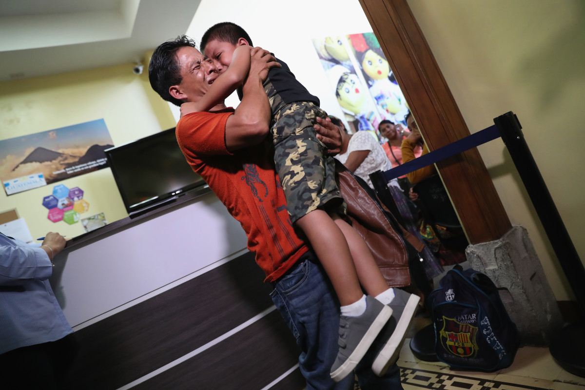 "An emotional father embraces his son for the first time in months on August 7th, 2018, in Guatemala City, Guatemala. They had been separated as part of the Trump administration's ""zero tolerance"" policy at the border."