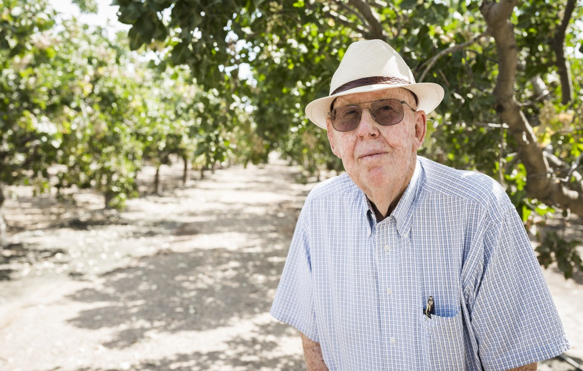 Fred Starrh in a pistachio grove in Shafter, California, where Starrh Family Farms, now a 10,000-acre operation, began on a 30-acre parcel of land.