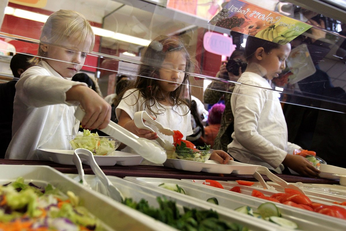 Students at Nettelhorst Elementary School dig into a salad bar in the school's lunchroom on March 20th, 2006, in Chicago, Illinois.
