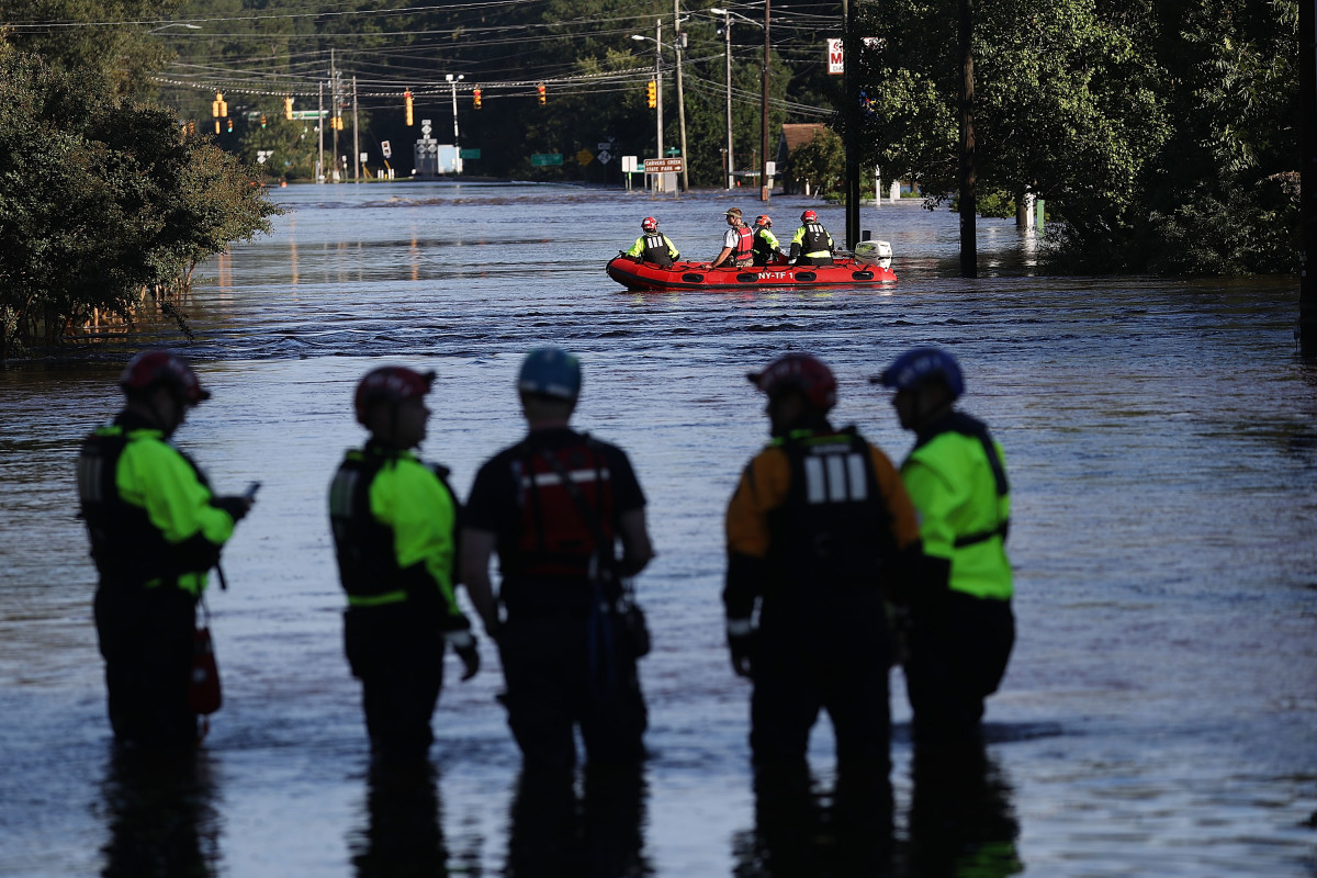 Members of New York Urban Search and Rescue Task Force One work in an area flooded with waters from the Little River as it crests from the rains caused by Hurricane Florence as it passed through the area on September 18th, 2018, in Spring Lake, North Carolina.