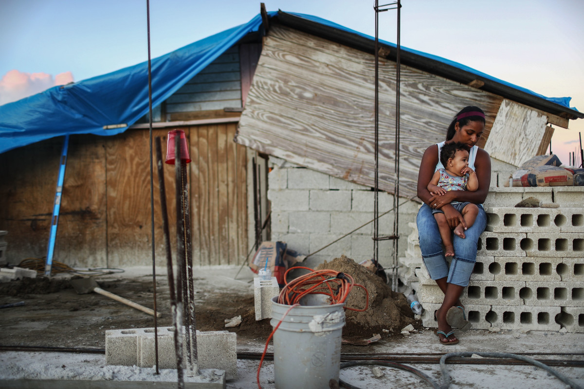 Isamar holds her nine-month-old baby at their makeshift home in San Isidro, Puerto Rico, on December 23rd, 2017.