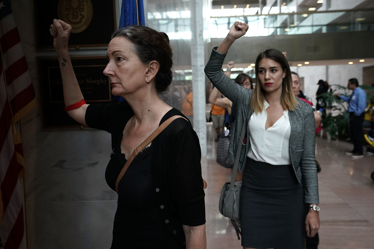 In protest against Supreme Court nominee Judge Brett Kavanaugh, activists chant slogans outside the office of Senate Judiciary Committee Chairman Senator Chuck Grassley (R-Iowa) on September 20th, 2018, at Hart Senate Office Building on Capitol Hill in Washington, D.C.