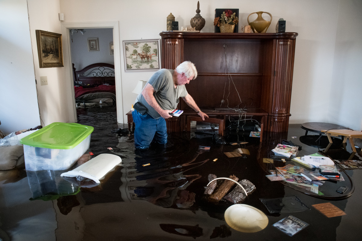Billy Hardee removes valuables from his home as floodwater from Hurricane Florence rises at Aberdeen Country Club on September 20th, 2018, in Longs, South Carolina.