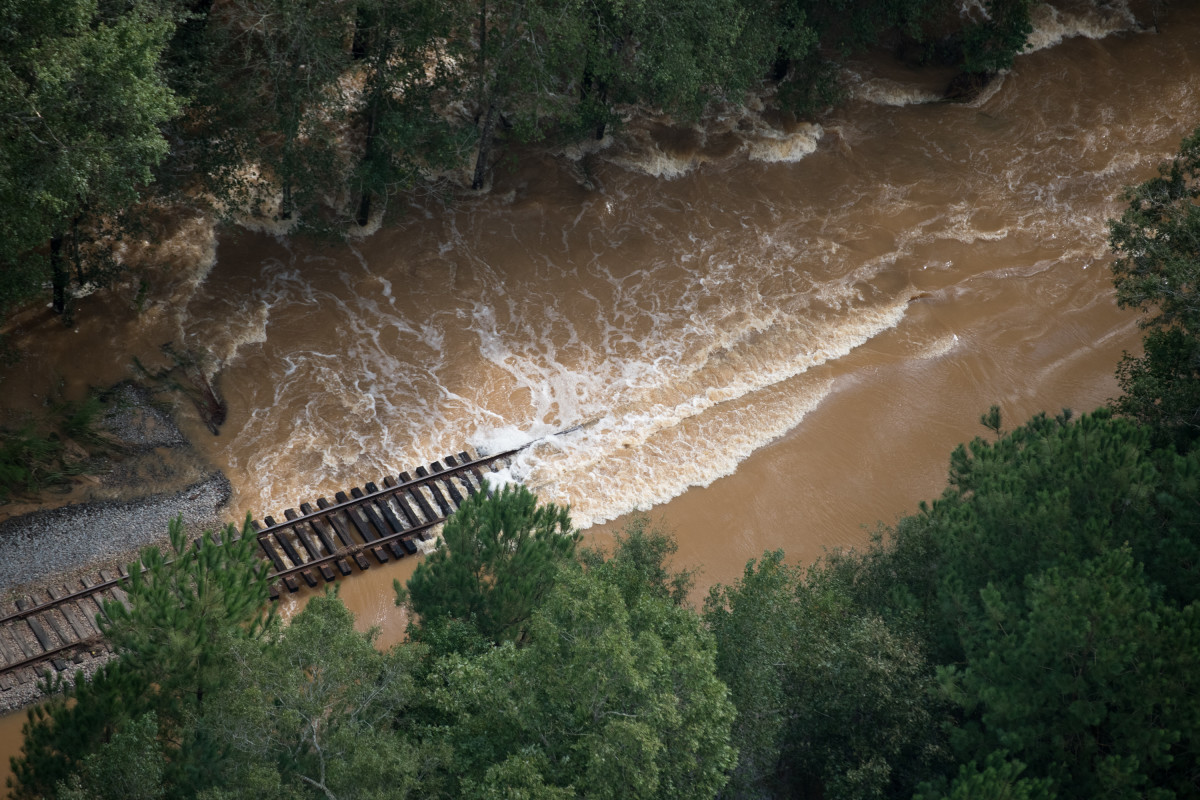 Floodwaters flow over train tracks on September 17th, 2018, in Dillon, South Carolina. Many rivers in the Carolinas were approaching record flood stages due to Hurricane Florence as their levels continued to rise through the week.