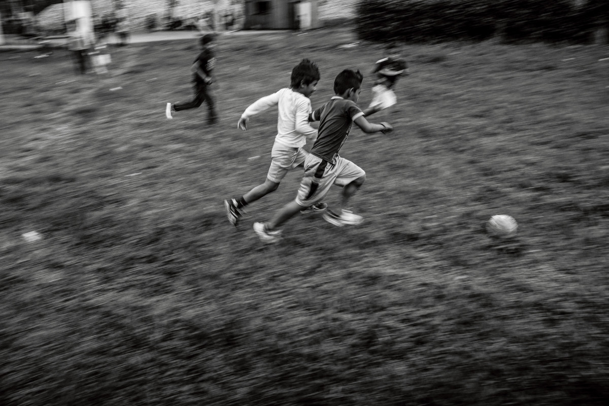 Cofán boys playing soccer in Dureno. Both children and young adults play soccer and volleyball nearly every afternoon.