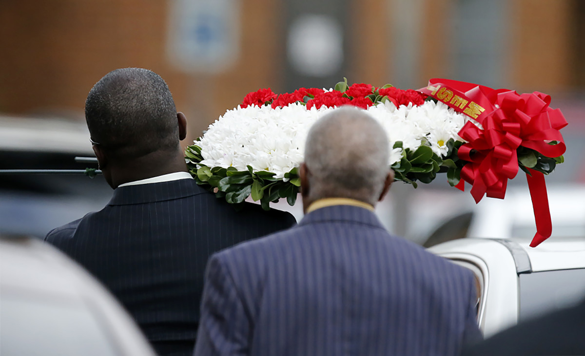 Mourners carry a wreath of flowers at the funeral service for Botham Shem Jean at the Greenville Avenue Church of Christ in Richardson, Texas, on September 13th, 2018.