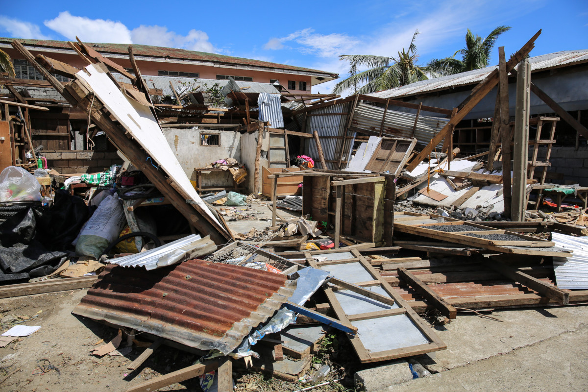 A house lies overturned outside Baggao.