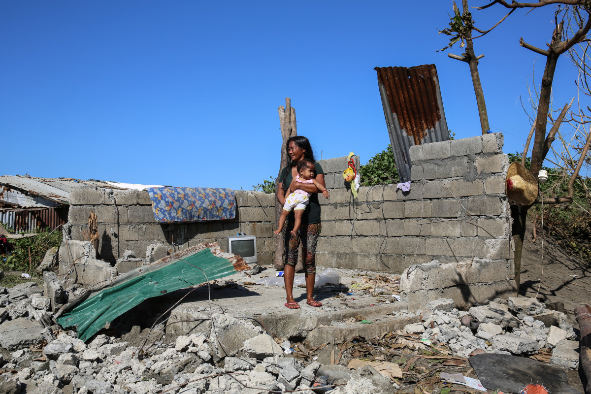 "Maya Banadero, 34, stands in her home in Aparri. ""We lost everything but not a single life in Aparri. I thank God for that,"" she says."