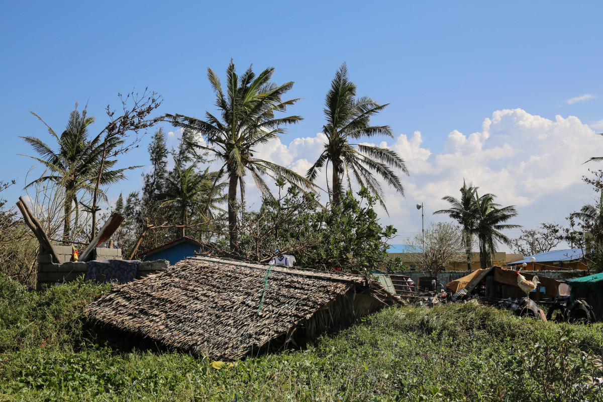 """The roof of Maya Banadero's home lies next to the foundation. """"We only built this home four months ago,"""" she says."""