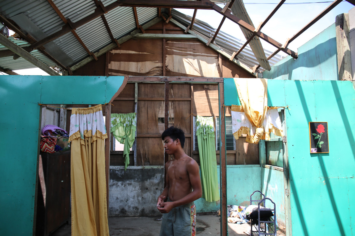"Sixteen-year-old Calvin John Caballo lost half of his roof to the typhoon. ""I will start building today and this time I will build a stronger roof and a stronger house for my family,"" he says."