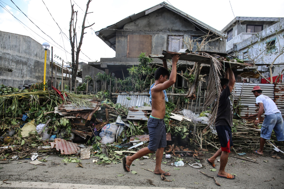 Clean-up begins in Aparri after Typhoon Manghut tore through its streets.