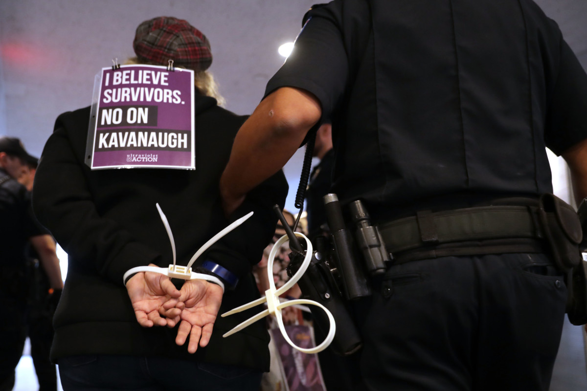 U.S. Capitol Police arrest protesters who were demonstrating against the confirmation of nominee Brett Kavanaugh in the Hart Senate Office Building on September 25th, 2018.