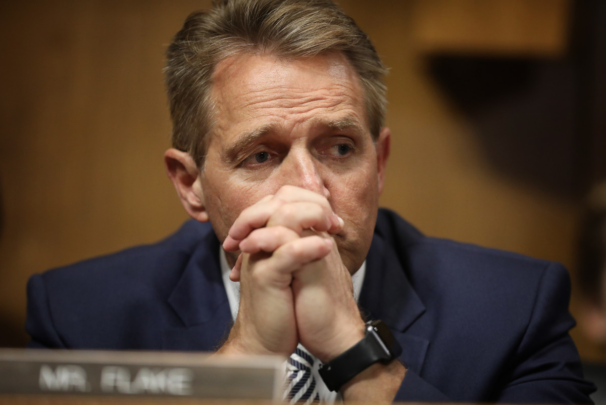 Senator Jeff Flake listens to Democratic senators speak during a Senate Judiciary Committee meeting on September 28th, 2018, in Washington, D.C.