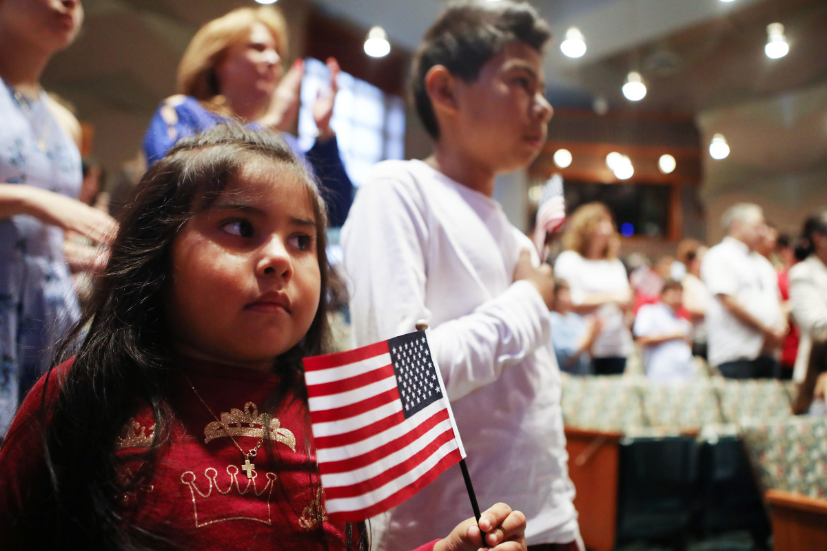 New U.S. citizen Davies Garcia, 11, originally from Mexico, stands with his sister, Valerie, during a naturalization ceremony conducted by U.S. Citizenship and Immigration Services on September 14th, 2018, in Los Angeles, California.