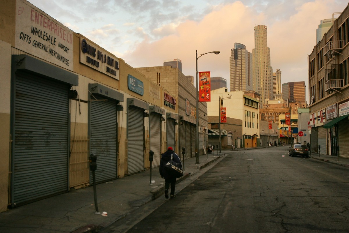 A homeless man walks down the street in the downtown Skid Row area of Los Angeles, California.